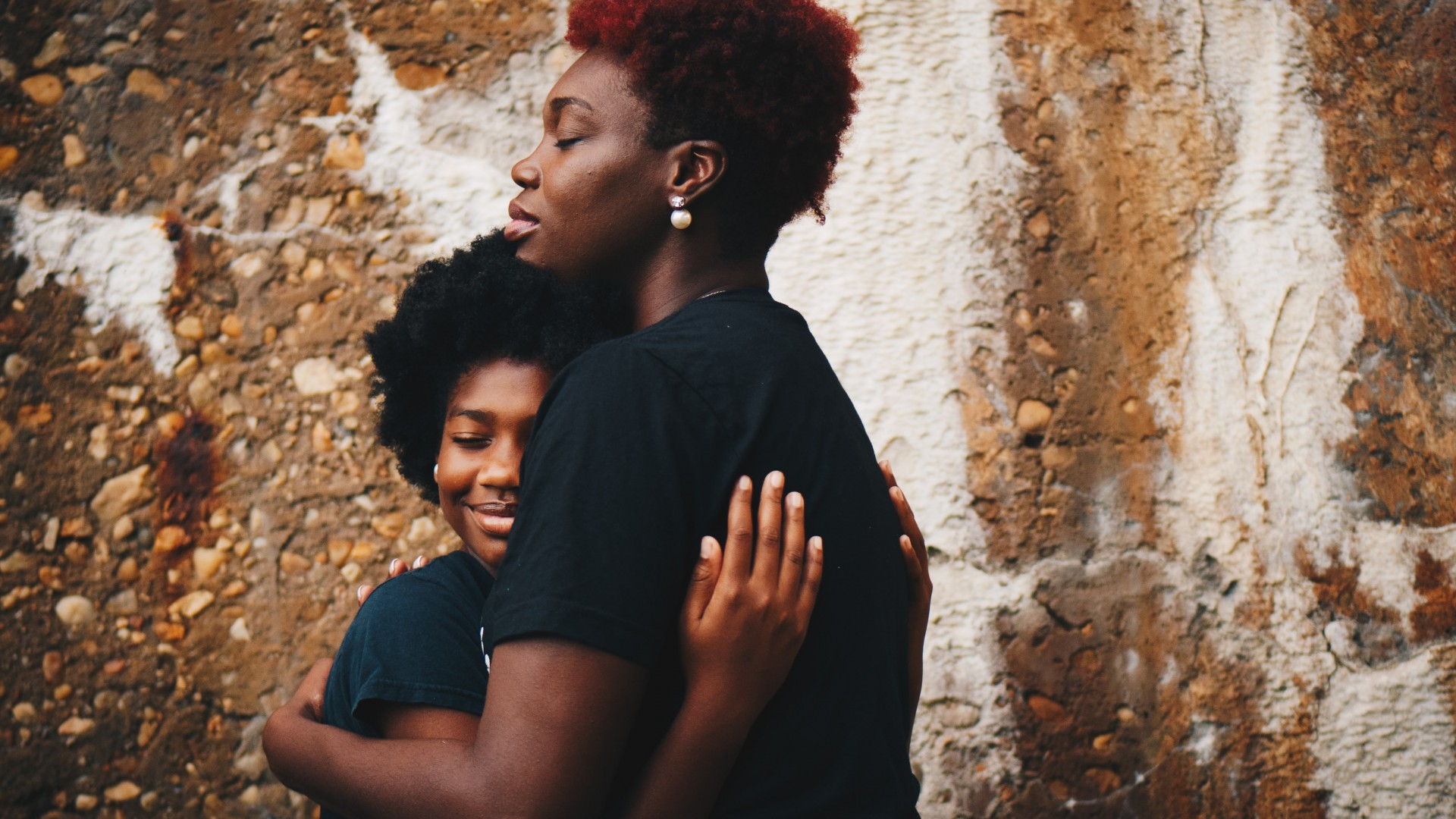 Parent and child hugging; Photo by Eye for Ebony on Unsplash