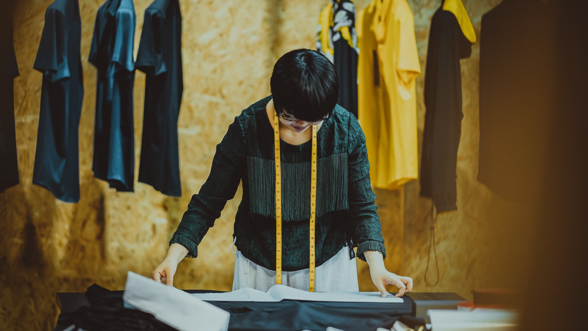 Seamstress working in a shop; Photo by Kenny Luo on Unsplash